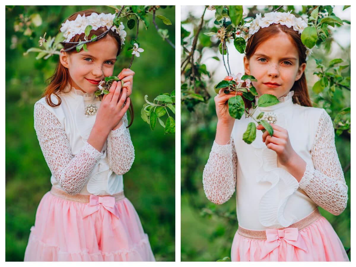 Dziewczynka w stylizacji na rozpoczęcie roku szkolnego z białą bluzką i spódniczką
